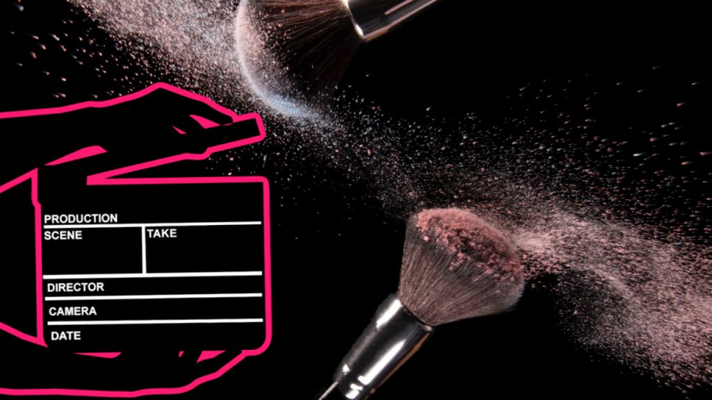 Makeup brushes with flying dust and a cinema clapper