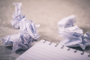 Balled up paper to symbolise writer's block or creative rut