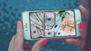 dollars and euros on a phone screen - content making money
