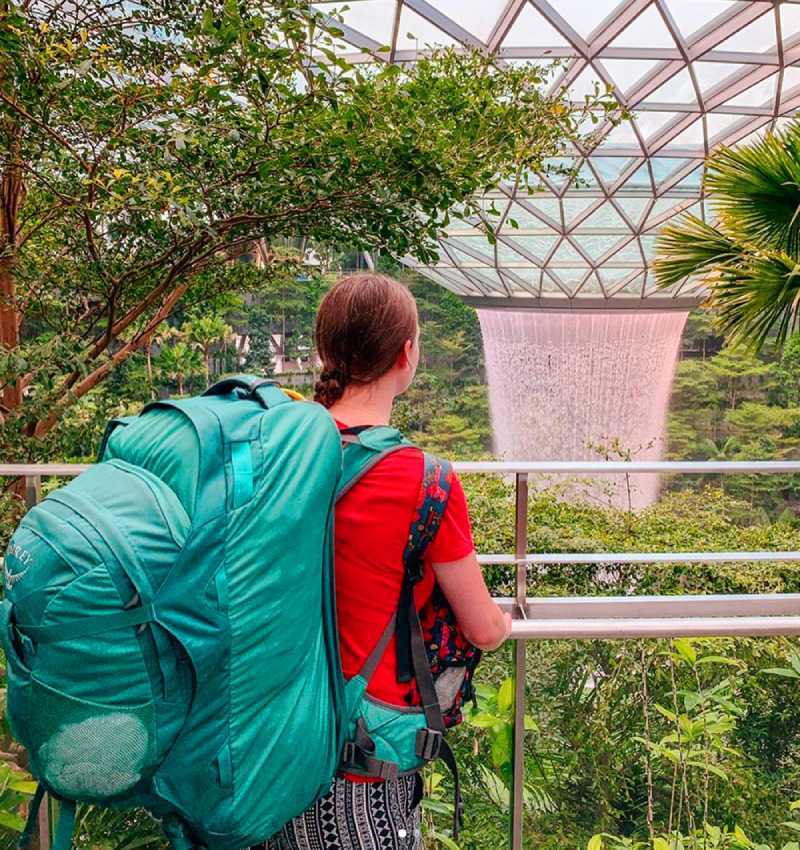 travel blogger with backpack - how to make money form your travel blog